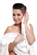 Young woman with short haircut in towel