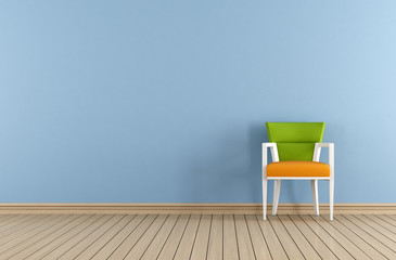 Blue interior with chair against blue wall