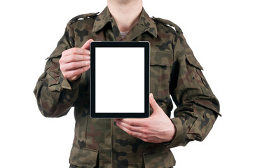 soldier holding blank digital tablet isolated on white backgroun