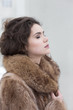 Affectionate Dreamy Sensual Woman in Fur Coat in Reverie. Serene