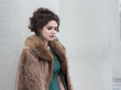 Elegance. Charming Autumn Brunette in Fur Coat in her Thoughts