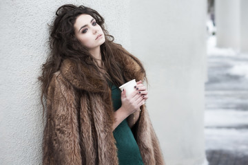 Breaktime. Thoughtful Woman holding Coffee Cup and Relaxing