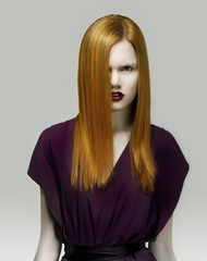 Exquisite Golden Hair Stylish Woman in Violet Dress. Arrogance