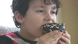 Little boy likes donut