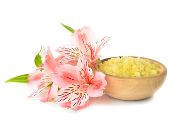 Sea salt and flowers on white background