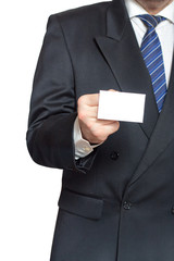 A man holding a business card in his hand