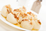 Meat stuffed dumplings with fried onion. Selective focus