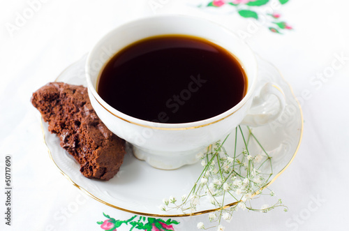 A Cup of coffee with chocolate biscuits