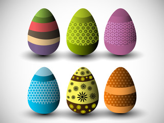 Colorful, beautifully decorated Easter Eggs on grey background