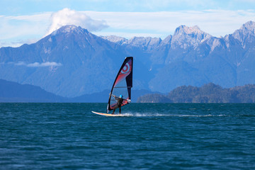 Windsurfer on mountain lake