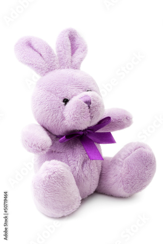 Toys: small pink or lilac rabbit, isolated on white background