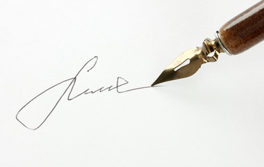 Closeup of signature (fake, not real) and ink pen, isolated