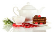 Teapot, cup of tea and delicious cake isolated on white