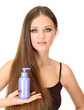Woman with long hair holding bottle of shampoo, isolated