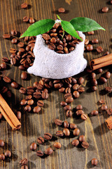 Sprout in coffee in sack on wooden table