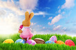 Colorful Easter eggs and bunny on the perfect meadow