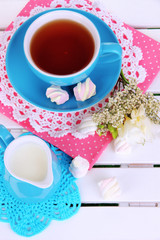 Beautiful tea composition on wooden picnic table close-up