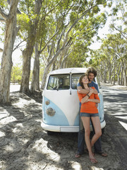 Young Couple in Front of Camper Van