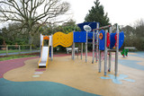 Slide and other equipment in a children's play ground