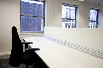 Close up of office chair and empty desk by window