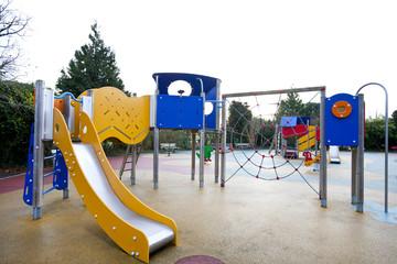Slide and climbing web in children's playground