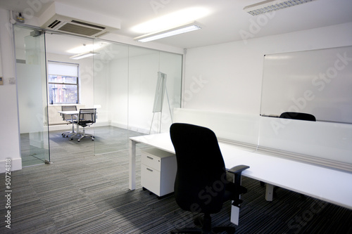 Office desk with meeting room in background