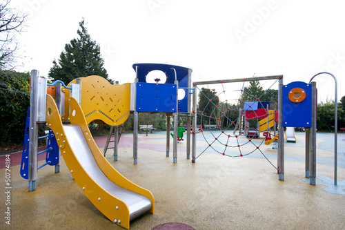 Slide and climbing web in children's playground