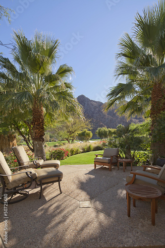 Patio with relaxing chairs and gardens