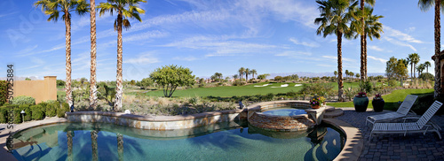 Panoramic view of swimming pool, hot tub and golf course