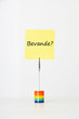 "Sticky notepaper with Italian text ""Bevande?"" (drinks) clipped to a multicolored card holder"