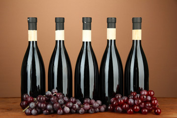 Wine bottles on brown background