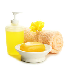 Bottle, soap-dish with soap and towel, isolated on white