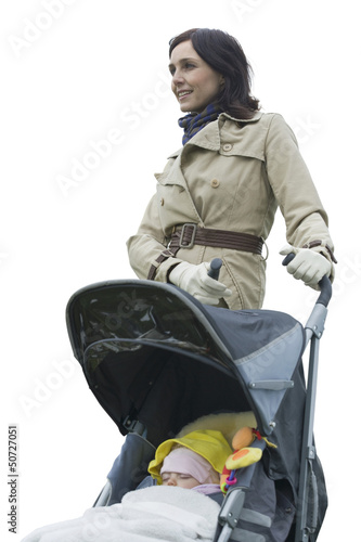 Mother with baby girl in carriage against white background