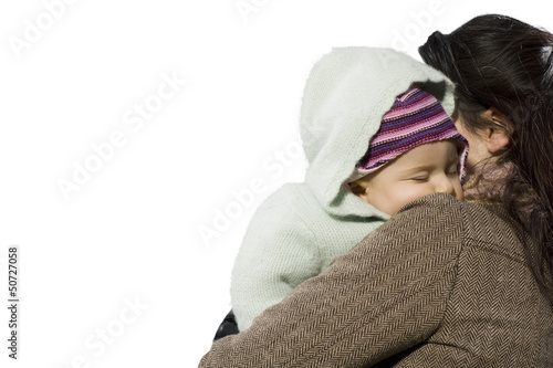 Portrait of beautiful mother holding baby girl against white background
