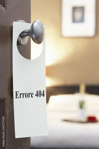 "Sign with Italian text ""Errore 404"" (Error 404) hanging on hotel room door"