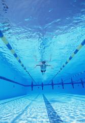 Underwater shot of male athlete swimming in pool