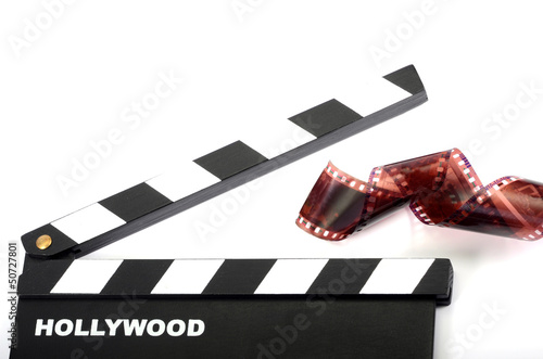 Movie clapper board  and film strip isolated