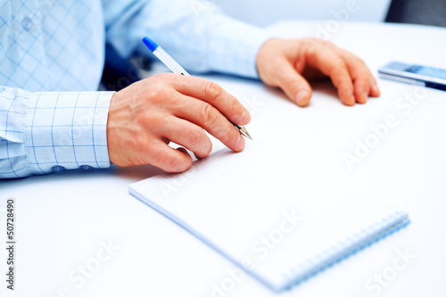 Image of businessman writing