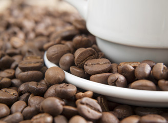 coffee grains near a cup