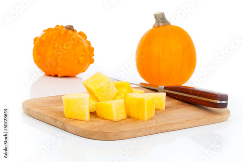 sliced pumpkin, ready for cooking. isolated on white