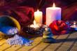 four candles camellias stones and salt