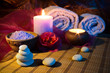 two candles towels camellias stones and salt.jpg