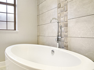 Interior design detail of a Luxury bath tub and faucet