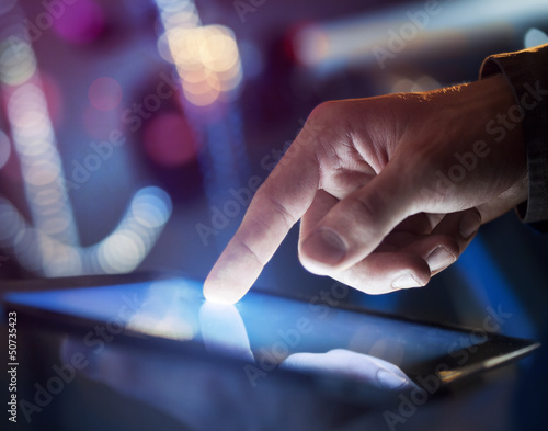 tablet in hand - 50735423