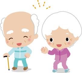 ウォーキング中の白髪の老夫婦