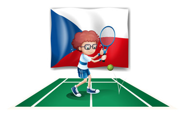 A boy playing tennis in front of the Czech Republic flag