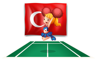 The flag of Turkey and the energetic cheerdancer