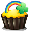 A cupcake with a rainbow and a plant