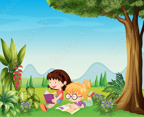 Two girls reading near the plants