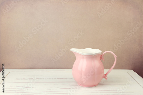 Pink jug on wooden vintage table